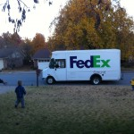 We were walking outside for an Adventure Walk (ie- me trying to keep them alive while walking in our neighborhood...) and the FedEx truck pulled up with the Full Core. That is Bug running to the truck- clearly the FedEx driver is more concerned than I was...